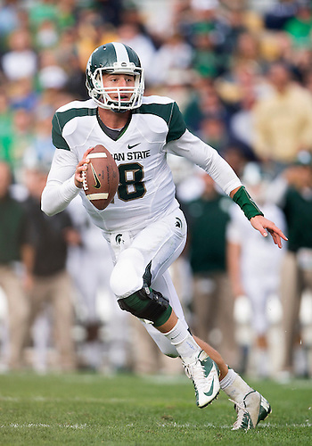 September 21, 2013:  Michigan State quarterback Connor Cook (18) scrambles out of the pocket during NCAA Football game action between the Notre Dame Fighting Irish and the Michigan State Spartans at Notre Dame Stadium in South Bend, Indiana.  Notre Dame defeated Michigan State 17-13.