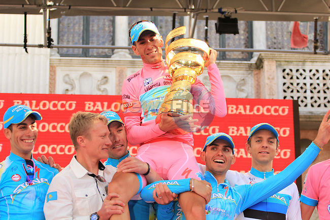 Vincenzo Nibali (ITA) Astana Pro Team lwith his team mates and the beautiful trophy after winning the overall classification and the Maglia Rosa at the end of Stage 21 from Riese Pio X to Brescia of the 2013 Giro d'Italia. 26th May 2013.<br /> (Photo:Thomas Van Bracht/www.newsfile.ie)