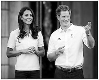 Catherine The Duchess of Cambridge accompanied by Prince Harry watch Wai-Ming hand over the London 2012 Olympic Torch to John Hulse at Buckingham Palace...Tel: 07515 876520.e mail: kelvin@kisforkate.com