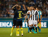 Calcio, Serie A: Inter vs Juventus. Milano, stadio San Siro, 18 settembre 2016.<br /> Inter's Mauro Icardi, left, celebrates with teammate Joao Mario as Juventus players, in background, leave the pitch at the end of the Italian Serie A football match between FC Inter and Juventus at Milan's San Siro stadium, 18 September 2016. Inter won 2-1.<br /> UPDATE IMAGES PRESS/Isabella Bonotto