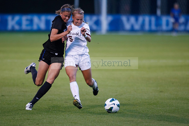 Freshman Forward  Kelli Hubly, fighting for the ball during the first half of the University of Kentucky vs. Texas A&M Women's soccer game. Photo by: Adam Chaffins