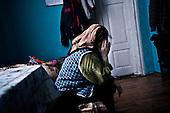 Czatachowice 01.2010 Poland<br /> An elderly woman has no electricity since 11 days.<br /> Three atmospheric forces: rain, snow and frost have changed into an ecological disaster the Myszkowski district in the Czestochowskie province, located 230 kilometers south of Warsaw. Almost 95% of all trees are down.Thousands of homes are left without electricity.<br /> Photo: Adam Lach / Napo Images for Newsweek Polska<br /> <br /> Starsza kobieta nie ma pradu od 11 dni - pali w kuchni piecem kaflowym.<br /> Wstepnie &quot;tylko&quot; 95% scietych drzew w dwoch powiatach. 0.5 miliona metrow szesciennych zniszczonych lasow..Tysiace gospodarstw bez pradu. Wszyscy maja swiadomosc, ze na kumulacje trzech niekorzystnych .zjawisk atmosferycznych rady nie ma.Trzy zjawiska kt&oacute;re zamienily jeden z obszarow Polski w istna katastrofe ekologiczna: deszcz, snieg i szadz.<br /> Fot: Adam Lach / Napo Images dla Newsweek Polska