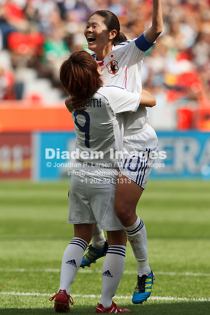 LEVERKUSEN, GERMANY - JULY 1:  Japan team captain Homare Sawa (10) and teammate Nahomi Kawasumi (9) celebrate after Sawa scored a goal during a FIFA Women's World Cup Group B match against Mexico July 1, 2011 at FIFA Women's World Cup Stadium in Leverkusen, Germany.  Editorial use only.  (Photograph by Jonathan P. Larsen)