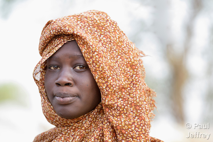 A displaced woman in Agok, a town in the contested Abyei region where tens of thousands of people fled in 2011 after an attack by soldiers and militias from the northern Republic of Sudan on most parts of Abyei. Although the 2005 Comprehensive Peace Agreement called for residents of Abyei--which sits on the border between Sudan and South Sudan--to hold a referendum on whether they wanted to align with the north or the newly independent South Sudan, the government in Khartoum and northern-backed Misseriya nomads, excluded from voting as they only live part of the year in Abyei, blocked the vote and attacked the majority Dinka Ngok population. The African Union has proposed a new peace plan, including a referendum to be held in October 2013, but it has been rejected by the Misseriya and Khartoum. The Catholic parish of Abyei, with support from Caritas South Sudan and other international church partners, has maintained its pastoral presence among the displaced and assisted them with food, shelter, and other relief supplies.