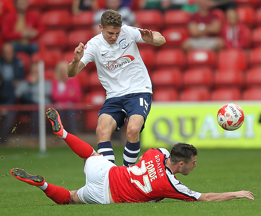 Preston North End's Calum Woods battles with  Walsall's Anthony Forde<br /> <br /> Photographer Mick Walker/CameraSport<br /> <br /> Football - The Football League Sky Bet League One - Walsall v Preston North End - Saturday 13th September 2014 - Banks's Stadium - Walsall<br /> <br /> &copy; CameraSport - 43 Linden Ave. Countesthorpe. Leicester. England. LE8 5PG - Tel: +44 (0) 116 277 4147 - admin@camerasport.com - www.camerasport.com