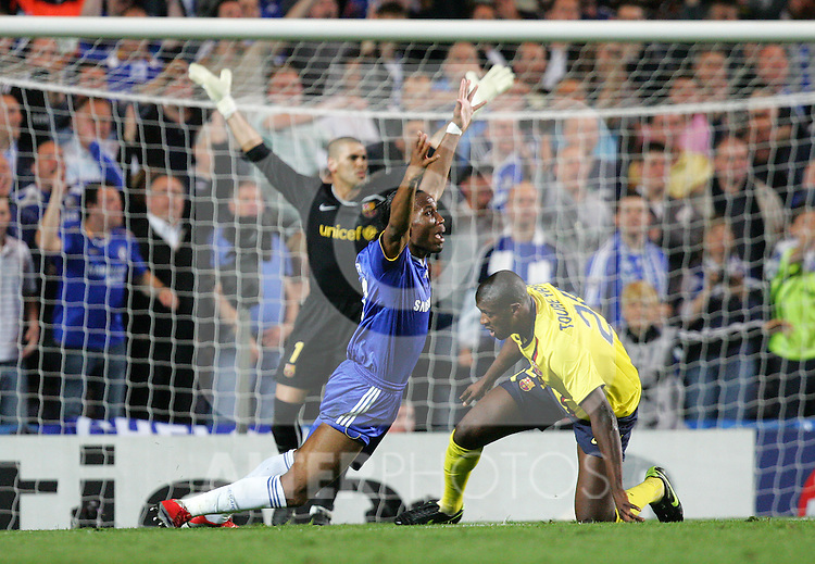 Didier Drogba of Chelsea reacts after being fouled in the penalty area during the UEFA Champions League Semi Final Second Leg match between Chelsea and Barcelona at Stamford Bridge on May 6, 2009 in London, England.