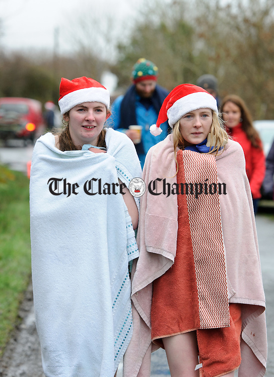A freezing Sinead and Aisling Reidy return after taking part in the annual Christmas day swim at Gortglas  Lake, Kildysart in aid of the West Clare Mini Marathon Cancer fund. Photograph by John Kelly.