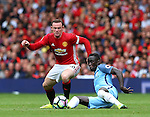 Wayne Rooney of Manchester United tackles Bacary Sagna of Manchester City during the Premier League match at Old Trafford Stadium, Manchester. Picture date: September 10th, 2016. Pic Simon Bellis/Sportimage
