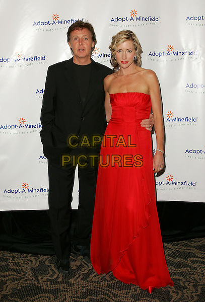 SIR PAUL McCARTNEY & HEATHER MILLS McCARTNEY.The 4th Annual Benefit Gala for Adopt-A-Minefield held at The Century Plaza Hotel in Century City, California.October 15th, 2004.full length, married, husband, wife, red strapless dress, arm around waist, black suit, hand in pocket.www.capitalpictures.com.sales@capitalpictures.com.©Debbie Van Story/Capital Pictures