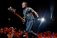 Aug. 11, 2009 - St. Louis, Mo., USA - Green Day's MIKE DIRNT performs at the Scottrade Center on the band's 2009 Tour. (Credit Image: © Sarah Conard/ ZUMA Press)
