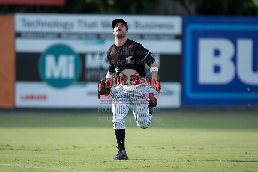 Kannapolis Intimidators left fielder Luis Gonzalez (6) chases after a fly ball during the game against the Greensboro Grasshoppers at Kannapolis Intimidators Stadium on August 13, 2017 in Kannapolis, North Carolina.  The Grasshoppers defeated the Intimidators 3-0.  (Brian Westerholt/Four Seam Images)