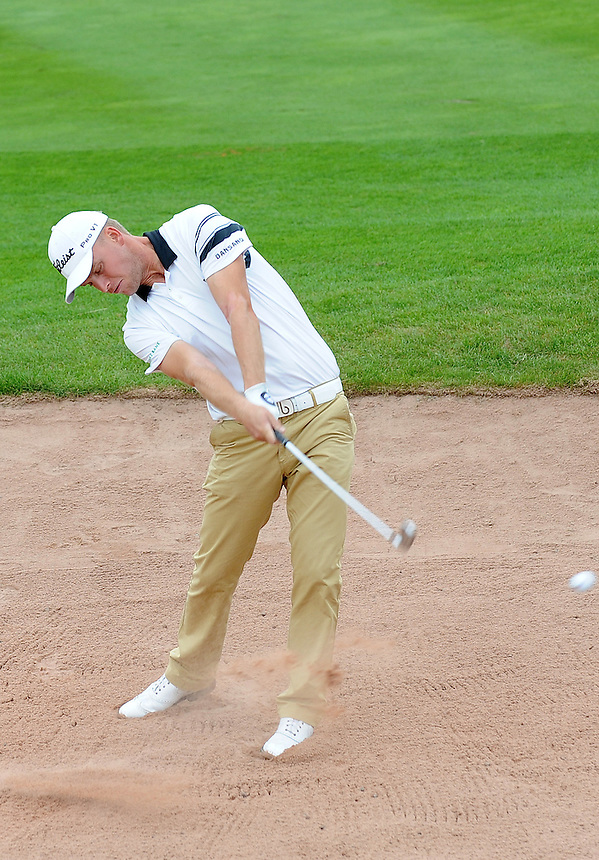 Denmark's Morten Orum Madsen hits a fairway bunker shot on the second hole<br /> <br /> Photo by Ian Cook/CameraSport<br /> <br /> Golf - Day 1 - ISPS Handa Wales Open 2013 - Twenty Ten Course- Thursday 29th August 2013 - Celtic Manor Resort  - Newport<br /> <br /> &copy; CameraSport - 43 Linden Ave. Countesthorpe. Leicester. England. LE8 5PG - Tel: +44 (0) 116 277 4147 - admin@camerasport.com - www.camerasport.com