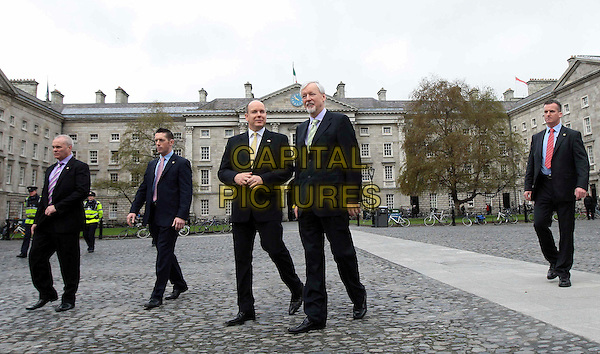 PRINCE ALBERT II OF MONACO & DR. JOHN HEGARTY (Director).Visits Trinity College during a State visit to Ireland, Book of Kells, Dublin, Ireland, 5th April 2011..full length royal black suit yellow tie walking .CAP/PPG/WS.©Willi Schneider/People Picture/Capital Pictures
