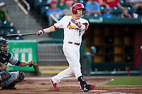 Colin Walsh (5) of the Springfield Cardinals follows through his swing after making contact with a pitch during a game against the Northwest Arkansas Naturals at Hammons Field on August 20, 2013 in Springfield, Missouri. (David Welker/Four Seam Images)