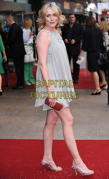 "KEELEY HAWES.attending the World Premiere of ""Sex and the City: The Movie"", Odeon Leicester Square, London, England, 12th May 2008..full length grey gray beige silver beaded dress shoes sandals purse .CAP/BEL.©Tom Belcher/Capital Pictures"