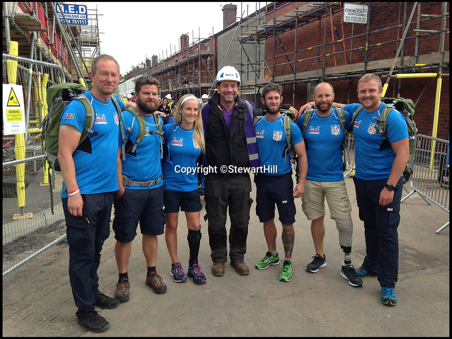 BNPS.co.uk (01202 558833)Pic: StewartHill/BNPS<br /> <br /> Stewart Hill (L) pictured with Nick Knowles at a Walking for the wounded event.<br /> <br /> An army hero who suffered life-changing injuries in Afghanistan is now forging a new career as a portrait painter after art became part of his recovery.<br /> <br /> To the unknowing eye Lt Col Stewart Hill looks a picture of health, but he has a severe traumatic brain injury after an IED exploded next to him nine years ago.<br /> <br /> Lt Col Hill was medically discharged from the army but his injuries make it impossible for him to maintain a 'normal' job.<br /> <br /> Struggling to come to terms with what had happened he turned to painting, something he had not done since school, as part of his therapy.<br /> <br /> But it has now turned into a career, with him winning prestigious prizes and lining up a host of well-known faces to sit for him including actor Ray Winstone, TV presenter Nick Knowles and choirmaster Gareth Malone.