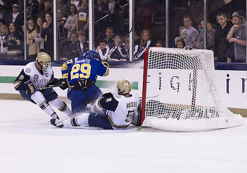 January 18, 2013:  Notre Dame goaltender Steven Summerhays (1) makes save on shot by Alaska right wing Andy Taranto (29) as Notre Dame defenseman Robbie Russo (5) defends during NCAA Hockey game action between the Notre Dame Fighting Irish and the Alaska Nanooks at Compton Family Ice Arena in South Bend, Indiana.  Alaska defeated Notre Dame 5-4.
