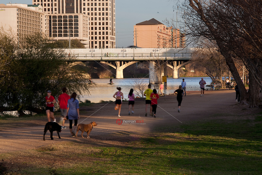 Runners and joggers take advantage of the the Lady Bird Lake Hike and Bike Trail; also favorite place to walk your dog or pet or go for a run in Austin, Texas