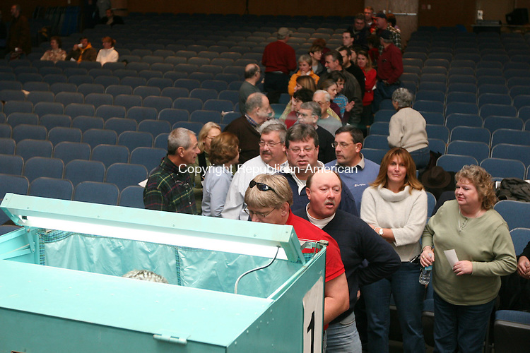 WINSTED, CT - 22 November, 2008 - 112208MO10 - Selectmen Gene Berlinski (dark blue, second in line), Kenneth J. Fracasso (light blie, third from right) and Jeffrey D. Liskin (white shirt, to Fracasso's left) line up to vote on a motion to cut $660,000 from the school side of a $32.1 milion 2008-09 spending package at Saturday's town meeting. Voters rejected further cuts 101-26 before sending the budget to a fifth referendum of the year Dec. 13. Jim Moore Republican-American.