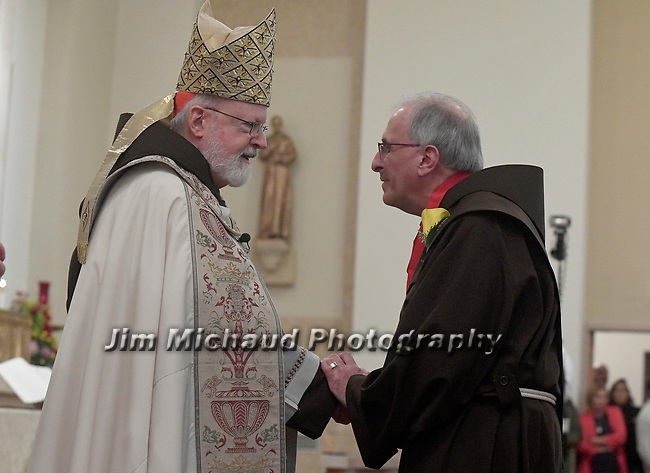 MALDEN MA NOVEMBER25: Cardinal Sean O'Malley congratulates Brother John Maganzini of Saint Anthony Shrine in Boston, after receiving the 2018 Cheverus award, one of the 125 recipients, Sunday, November 25, 2018, at the Immaculate Conception Church in Malden. (Herald Photo by Jim Michaud)