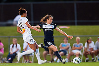 Sky Blue FC forward Kelley O'Hara (19) is marked by Western New York Flash defender Estelle Johnson (12). The Western New York Flash defeated Sky Blue FC 3-0 during a National Women's Soccer League (NWSL) match at Yurcak Field in Piscataway, NJ, on June 8, 2013.
