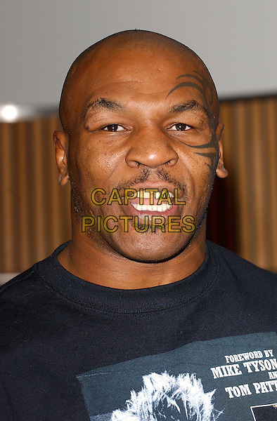 MIKE TYSON .At Big Joe Egan's Autobiograhy Book Signing at Books Etc. Canary Wharf, London, UK..November 17th, 2005.Ref: BEL.headshot portrait mustache facial hair tattoo mouth open gold tooth.www.capitalpictures.com.sales@capitalpictures.com.© Capital Pictures.