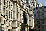 Statue of Lord Hartington against grand government buildings in Horse Guards Avenue, near Whitehall London
