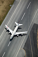 aerial photograph Boeing 747  JAL Japan Airlines runway center line San Francisco International airport SFO