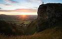 01/08/16<br /> <br /> A dog walker stops to admire the view as the first dawn of August breaks with a warming golden light as the sun rises over Winnats Pass near Castleton in the Derbyshire Peak District.<br /> <br /> <br /> All Rights Reserved, F Stop Press Ltd. +44 (0)1773 550665