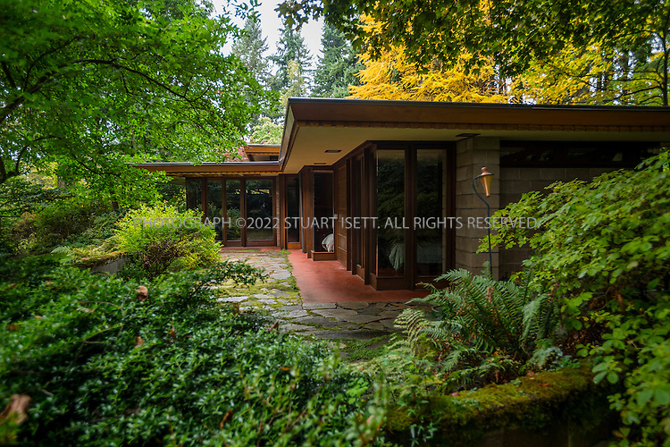 "10/9/2012--Sammamish, WA, USA..VIEW: Exterior showing rear of house with bedrooms on small, paved veranda...Architect Frank Lloyd Wright planned his ""Usonian"" homes to be affordable for middle-class families. The 1,9500 square foot Brandes home is for sale in Sammamish, Washington (30 minutes from Seattle) at $1.39 million. It features three bedrooms, two bathrooms and a small, separate office/study space...The home was built in 1952, and has redwood trim and Wright's original furniture and some garden sculptures by Wright. It's one of only three Frank Lloyd Wright homes near Seattle...©2012 Stuart Isett. All rights reserved."