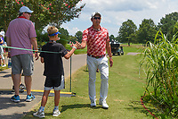 Mikumu Horikawa (JPN) high fives a young fan on his way to 13 during round 2 of the WGC FedEx St. Jude Invitational, TPC Southwind, Memphis, Tennessee, USA. 7/26/2019.<br /> Picture Ken Murray / Golffile.ie<br /> <br /> All photo usage must carry mandatory copyright credit (© Golffile | Ken Murray)