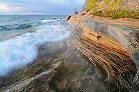 An evening glow illuminating the many layers of sandstone that make up the Pictured Rocks shoreline. Mosquito Beach, Munising, MI