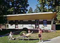 Windham Arms, Father and two sons sitting outside their small motel unit - 1959