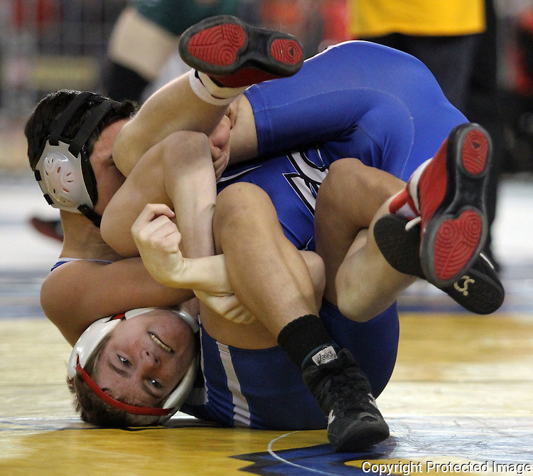 Eatonville's  Wyatt Schrader is turned upside down by Kiona-Benton's Angel Delangel in their 106 pound match on Saturday, February 20, 2016 at the Mat Classic XXVIII Championship matches held in the Tacoma Dome. Schrader took fourth place in the championships.  (Jim Bryant Photo)