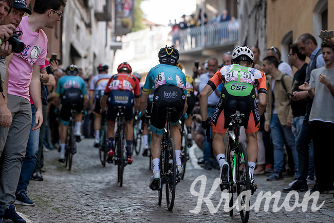 up the steep, cobbled & crowded climb in Pinerolo<br /> <br /> Stage 12: Cuneo to Pinerolo (158km)<br /> 102nd Giro d'Italia 2019<br /> <br /> ©kramon