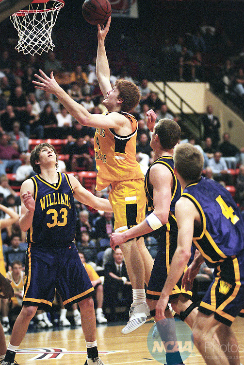 22 MAR 2003:  Doug Espenson (4) of Gustavus Adolphus drives to the hoop against Williams College during the Division 3 Men's Basketball Championship held at the Salem Civic Center in Salem, VA.  Williams defeated Gustavus Adolphus 67-65 for the national title.  Andres Alonso/NCAA Photos