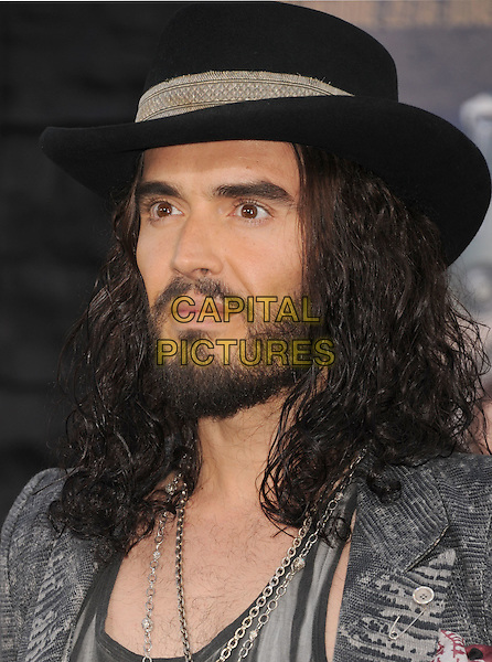 "Russell Brand.The Los Angeles Premiere of ""Rock Of Ages"" at Grauman's Chinese Theatre in Hollywood, California, USA..June 8th, 2012.headshot portrait black leather grey gray print jacket hat beard facial hair   .CAP/ROT/TM.©Tony Michaels/Roth Stock/Capital Pictures"