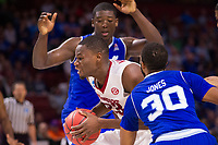 NWA Democrat-Gazette/J.T. WAMPLER Arkansas' Moses Kingsley drives to the basket between Seton Hall's Angel Delgado and Madison Jones (30) Friday Mar. 17, 2017 during the first round of the NCAA Tournament at the Bon Secours Wellness Arena in Greenville, South Carolina. Arkansas won 77-71 and will advance to the second round, playing Sunday at the same location.