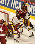 Willie Raskob (UMD - 15), Lewis Zerter-Gossage (Harvard - 77), Carson Soucy (UMD - 21) - The University of Minnesota Duluth Bulldogs defeated the Harvard University Crimson 2-1 in their Frozen Four semi-final on April 6, 2017, at the United Center in Chicago, Illinois.