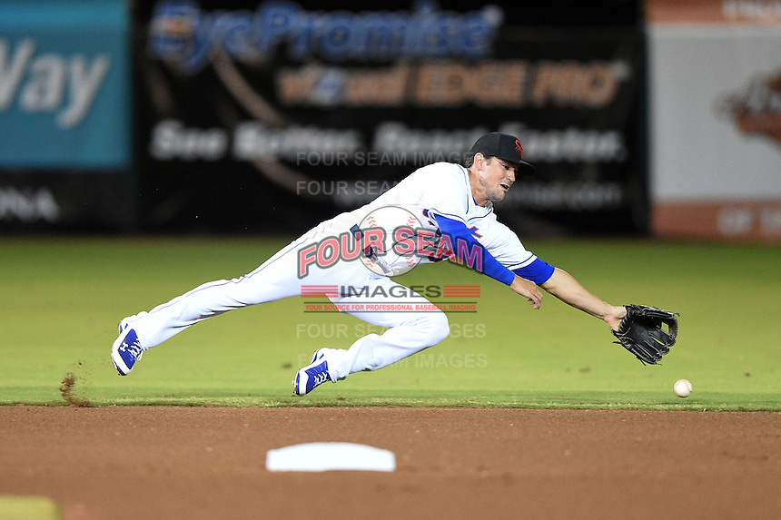 Scottsdale Scorpions infielder Matt Reynolds (3) dives for a hit up the middle during an Arizona Fall League game against the Salt River Rafters on October 8, 2014 at Scottsdale Stadium in Scottsdale, Arizona.  Salt River defeated Scottsdale 6-3.  (Mike Janes/Four Seam Images)