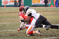 Jacksonville Jaguars safety Gerald Sensabaugh wraps up Dante Hall on a pass play during the second half at Arrowhead Stadium in Kansas City, Missouri on December 31, 2006. The Chiefs won 35-30.