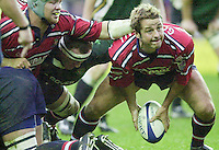 20/01/02 - Powergen  Cup - Quarter Final<br /> Madejski Stadium - Reading <br /> London Irish v Gloucester:<br /> Gloucester scrum half Andy Gommersall moves the ball away from the ruck.[Mandatory Credit:Peter SPURRIER/Intersport Images]