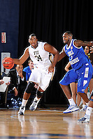 12 January 2012:  FIU's Joey De La Rosa (34) handles the ball while defended by MTSU's LaRon Dendy (1) in the first half as the Middle Tennessee State University Blue Raiders defeated the FIU Golden Panthers, 70-59, at the U.S. Century Bank Arena in Miami, Florida.