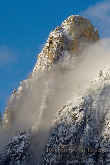 Morning light, fresh snow, and clearing spring clouds on Cathedral Rock, Yosemite Valley, Yosemite National Park, California