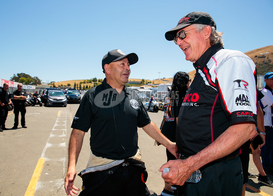 Jul 27, 2019; Sonoma, CA, USA; NHRA top fuel driver Mike Salinas (left) talks with Richard Hogan during qualifying for the Sonoma Nationals at Sonoma Raceway. Mandatory Credit: Mark J. Rebilas-USA TODAY Sports