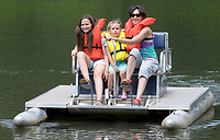 NWA Democrat-Gazette/DAVID GOTTSCHALK Devil's Den State Park Jennifer Ashwoth (from right) peddles and steers a paddleboat Monday, June 11, 2018, with her daughters Penelope, 10, and Finley back to the dock in the water of Lake Devil at the park. The three were enjoying the day father Chris and Abigail, 1. Amenities at the park also includes campsites, cabins, and extensive hiking system, swimming pool and visitor center.