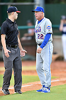 Kingsport Mets manager Rich Donnelly (22) talks to umpire Kaleb Devier during a game against the Elizabethton Twins at Joe O'Brien Field on July 6, 2019 in Elizabethton, Tennessee. The Twins defeated the Mets 5-3. (Tony Farlow/Four Seam Images)