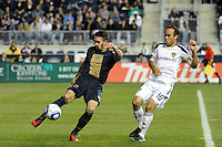 Danny Califf (4) of the Philadelphia Union plays the ball away from Landon Donovan (10) of the Los Angeles Galaxy. The Los Angeles Galaxy defeated the Philadelphia Union  1-0 during a Major League Soccer (MLS) match at PPL Park in Chester, PA, on October 07, 2010.