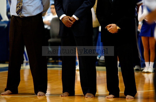 UK coachs stand for the national anthem barefoot to raise awareness for Samaritans Feet before UK's first exhibition game vs. Pikeville on Mon. Nov. 1, 2010. Photo by Britney McIntosh | Staff