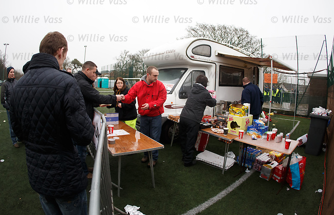 Queues for half-time pies and snacks from the Galabank catering caravan behind the stand